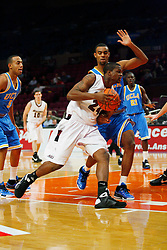 Nov 21, 2008; New York, NY, USA; Southern Illinois Salukis guard Wesley Clemmons (24) drives past UCLA Bruins forward Josh Shipp (3) during first half action of the 2K Sports Classic consolation game at Madison Square Garden.