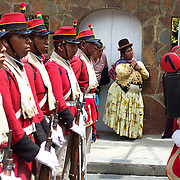 "An indigenous Bolivian lady watches the Bolivian soldiers of the historic Colorados battalion participate in a military parade to honor national hero Eduardo Avaroa as part of ""Day of the Sea"" celebrations. Bolivia lost its coastline 131 years ago to Chile in the ""Guerra del Pacifico"", or War of the Pacific.  Sopocachi, La Paz, Bolivia,  March 23, 2010."