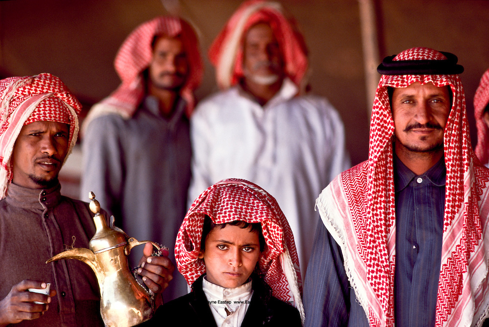 Men and boy camped at Jinayderiah for the annual camel race. Near Ridayh, Saudi Arabia