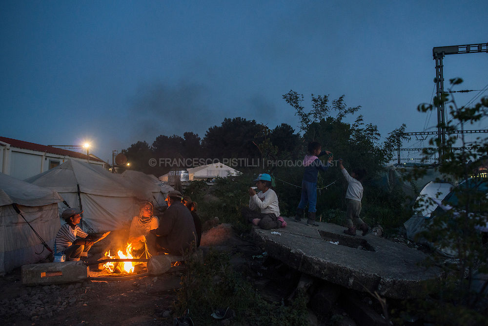 Syrian refugees having dinner along the railway at Idomeni camp. The railway connection has been blocked for a month by refugees who are protesting Macedonia's decision not to let them through. Police have tried to clear the tracks but refugees still resist and occupy the railway while waiting for an European solution.