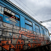 A young refugee peaks out his  window as the train departs Preevo, Serbia to the Croatian-Serbian border, January 2016.