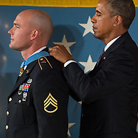 U.S. President Barack Obama awards Ty M. Carter, a former active duty U. S. Army Staff Sergeant, the Medal of Honor for conspicuous gallantry in the East Room of the White House August 26, 2013 in Washington D.C.  Photo Ken Cedeno