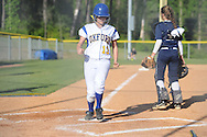 Oxford High's Lindsey Stout scores against Pearl catcher Cailee Arender (31) in MHSAA Class 5A playoff action in Oxford, Miss. on Friday, April 25, 2014.