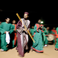 Khartoum, Sudan 18 April 2010<br /> Dervish during a ceremony. <br /> The Sufi are an Islamic religious brotherhood or orders. These orders emerged in the Middle East in the twelfth century in connection with the development of Sufism, a mystical current reacting to the strongly legalistic orientation of orthodox Islam. <br /> The orders first came to Sudan in the sixteenth century and became significant in the eighteenth. <br /> Sufism seeks for its adherents a closer personal relationship with God through special spiritual disciplines. <br /> Photo: Ezequiel Scagnetti