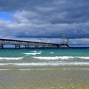 &quot;Span the Straits&quot; 2 <br /> <br /> The beautiful Mackinac Bridge crossing over the straits of Mackinac. Layers of clouds, and colors of water and waves in all hues of blue!!<br /> <br /> Mackinac Bridge by Rachel Cohen