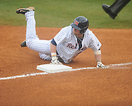 Ole Miss' Tanner Mathis (12) is safe at third vs. UT-Martin at Oxford-University Stadium in Oxford, Miss. on Wednesday, February 20, 2013. Ole Miss won 15-2 to improve to 4-0.