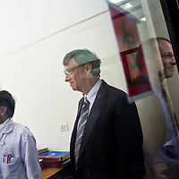 Bill Gates (center), co-chairman of the Bill and Melinda Gates Foundation (BMGF), and Peter Small (right), BMGF Deputy Director of TB, enters a laboratory as doctors give them a tour of the Lala Ram Swawrup (LRS) Institute of Tuberculosis and Respiratory Diseases in New Delhi, India on 24th March 2011.