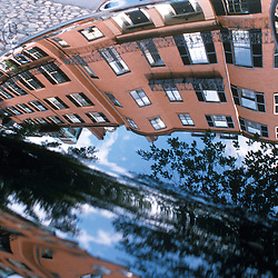 Louisburg Square homes reflected in hood of luxury automobile, Beacon Hill, Boston, MA.