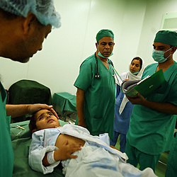 Mohammed Yousuf, 4, is comforted by doctors before undergoing surgery for pelviureteric junction obstruction of the kidney at the Children's Hospital at the Pakistan Institute of Medical Sciences in Islamabad, Pakistan, Sept. 18, 2007.