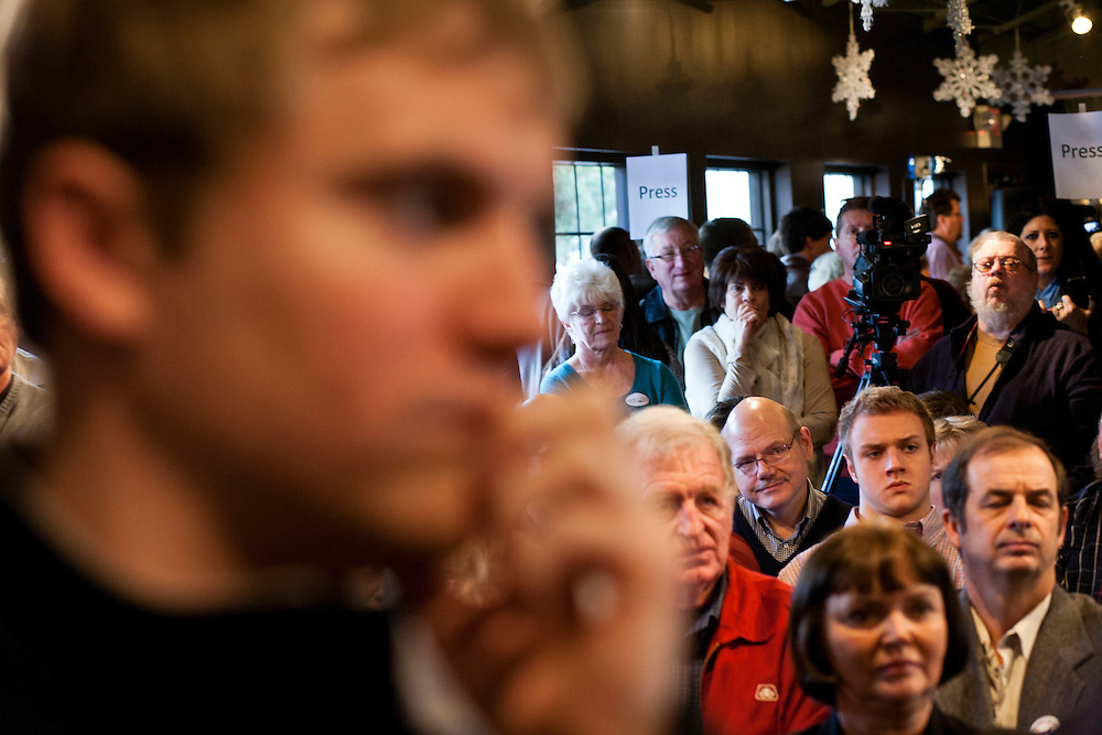 People listen as Republican presidential candidate Newt Gingrich speaks at Tish's Restaurant on Saturday, December 31, 2011 in Council Bluffs, IA.