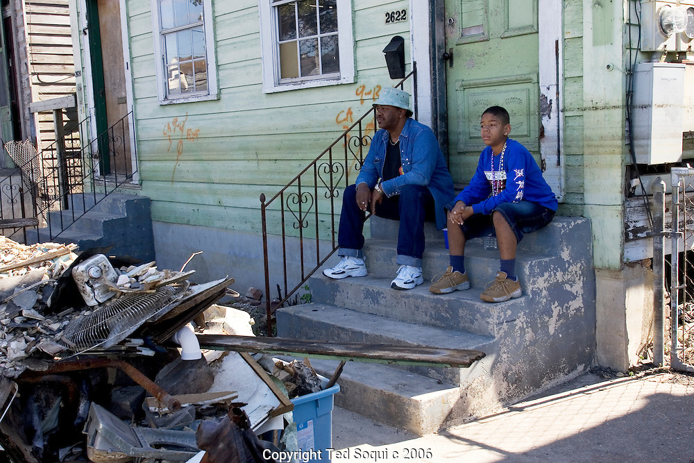 Residents of the 5th ward watching the Zulu second line parade..Mardis Gras six months after hurricane Katrina damaged much of New Orleans. The city is still empty in the lower 9th and ward and St. Bernards Parish, but many of the cities residents came back to participate and celebrate..
