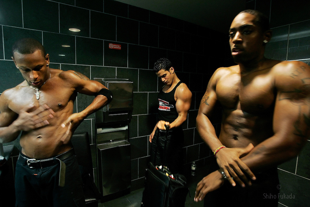 Male strippers prepare for a show in New York, Saturday, May 13, 2006.