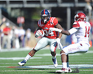 Ole Miss' Brandon Bolden (34) runs vs. Arkansas safety Eric Bennett (14) at Vaught-Hemingway Stadium in Oxford, Miss. on Saturday, October 22, 2011. .