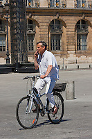 cyclist on Place Vendôme Paris France in May 2008