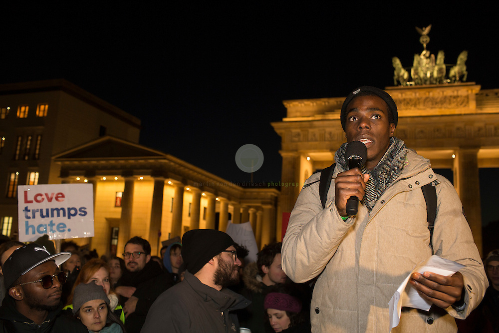 BERLIN, Brandenburg Gate, 12.11.2016 / Hundreds of people, among them many Americans, gathered in the center of the German capital to protest against President-elect Donald Trump.<br /> <br /> About 700 protesters followed a Facebook initiative to rally at the Brandenburg Gate, next to the U.S. Embassy. At this peaceful event, everyone was invited to speak out against Trump and to describe the expectations in the 45th president of the United States. Many spoke about the fear of growing discriminations against minorities.<br /> <br /> This man spoke about his fears as a gay black person under a President Trump.