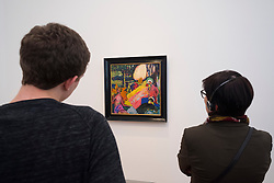 Visitors looking at painting, White Sound by Wassily Kandinsky,  at new Museum Barberini in Potsdam Germany