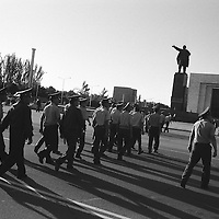 Eight years after the country declared its independence, in 1991,  from the Soviet Union a statue of Lenin still looks over Ala-Too Square, formerly Lenin Square, and a group of Kyrgyz police, in the capital city of Bishkek, Kyrgyzstan.
