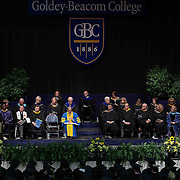 Keynote speaker Samuel A. Calamine III, LEFT, Founder and President of Dogfish Head Craft Brewery address students during Goldey-Beacom commencement exercise Friday, May 1, 2015, at Joseph West Jones College Center on the campus of Goldey-Beacom College in Wilmington Delaware.