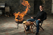 "Cookbook ghost writer, author, and grill specialist David Joachim admits he's ""a little bit of a pyromaniac,"" when it comes to cooking. He's literally cooking (a sausage) with fire in his home's backyard in Central Valley, Pennsylvania , on Monday, November 12, 2012."