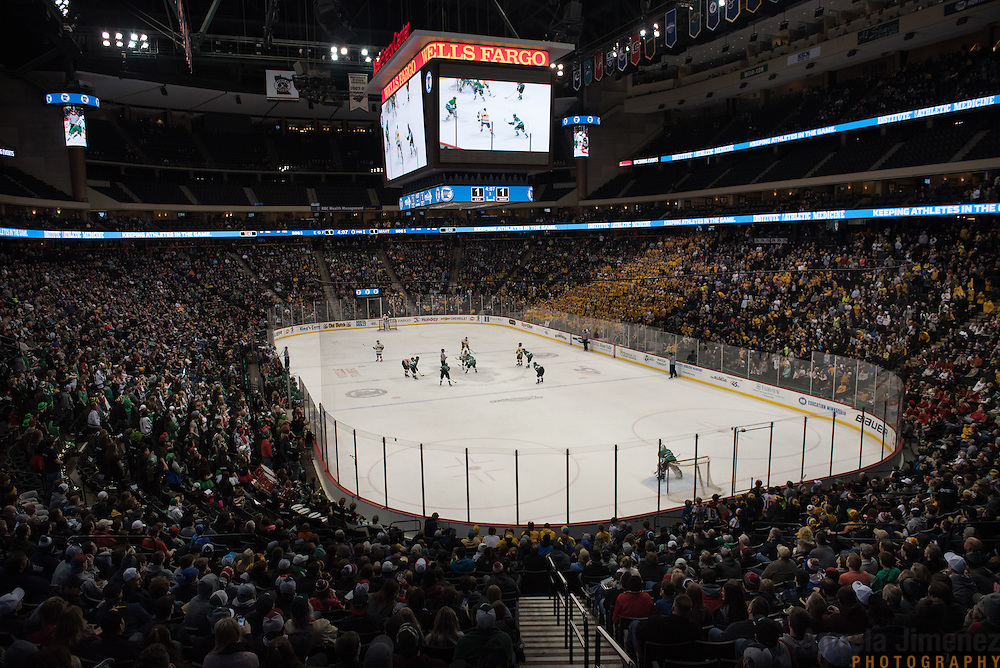 Fans watch the Class A semifinal game between Mahtomedi and East Grand Forks (East Grand Forks won 5-2) at the Minnesota State High School League Boys' State Hockey Tournament at the Xcel Energy Center in St. Paul, Minnesota on March 6, 2015. <br />  <br /> <br /> Photo by Angela Jimenez for Minnesota Public Radio www.angelajimenezphotography.com