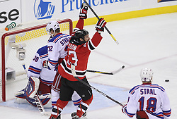 May 21, 2012; Newark, NJ, USA; New Jersey Devils right wing David Clarkson (23) celebrates his assist on a goal by New Jersey Devils defenseman Bryce Salvador (24) during the first period in game four of the 2012 Eastern Conference Finals at the Prudential Center.