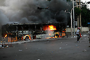 Violence between the 'Red Shirts' of the UDD and police / government military forces on the city streets of Bangkok. The UDD (United Front for Democracy Against Dictatorship) says Prime Minister Abhisit Vejjajiva came to power illegitimately and is a puppet of the military. The movement is made up of supporters of former Prime Minister Thaksin Shinawatra who was ousted in a coup in September 2006. The UDD wants Mr Abhisit to resign and call fresh elections.