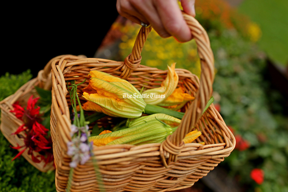 Edible flowers and herbs- including squash blossoms. (Erika Schultz / The Seattle Times)