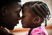 BEAUFORT, SC - JULY 14: CJ Cummings touches noses with his niece Christian Cummings before his weightlifting coach picks him up for practice on July 14, 2014 in Beaufort, South Carolina. Cummings, who is 5-foot-2, is part of a resurgence of interest in Olympic weightlifting in the U.S. (Photo by Stephen B. Morton for The Washington Post)