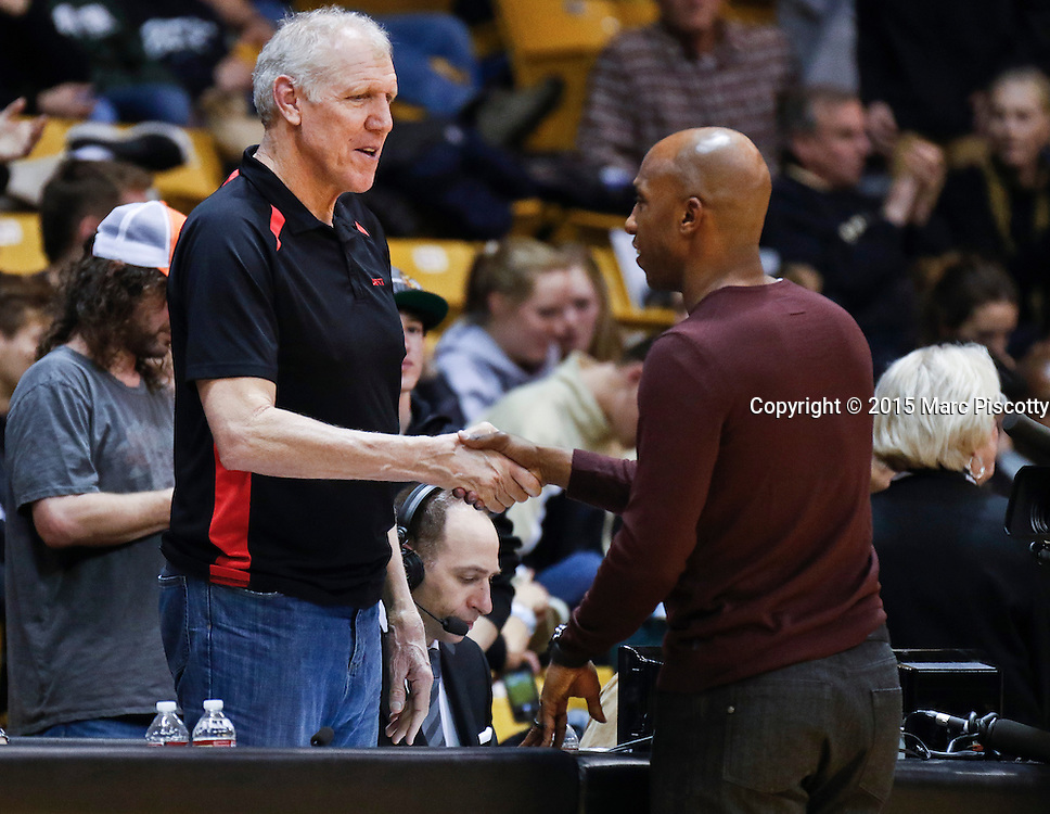 SHOT 2/26/15 9:06:51 PM - Former NBA greats Bill Walton (left) and Chauncey Billups talk during a regular season Pac-12 basketball game between Colorado and Arizona at the Coors Events Center in Boulder, Co. Arizona won the game 82-54.<br /> (Photo by Marc Piscotty / &copy; 2015)