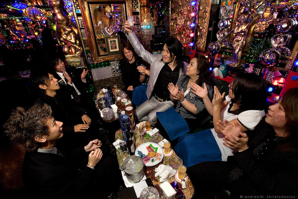 "Hosts entertaining female customers in club ""Ai"". Club ""Ai"" (love in Japanese) is one of the oldest host clubs in Kabukicho entertainment area near Shinjuku. It started functioning 37 years ago, with hosts ready to take care of the needs of their female customers. The customers have to pay from 5000 friendly price for beginners, to millions of yen, depending on how good the host is in pleasing the customer and encouraging her to buy drinks. On top of these a good host can receive expensive gifts from his regular customers.  Tokyo - JAPAN"