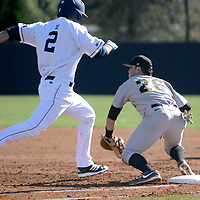 UNCW's Ryan LaGrange makes it safely to first as VCU's Trevor Marino can't make the tag. (Jason A. Frizzelle)