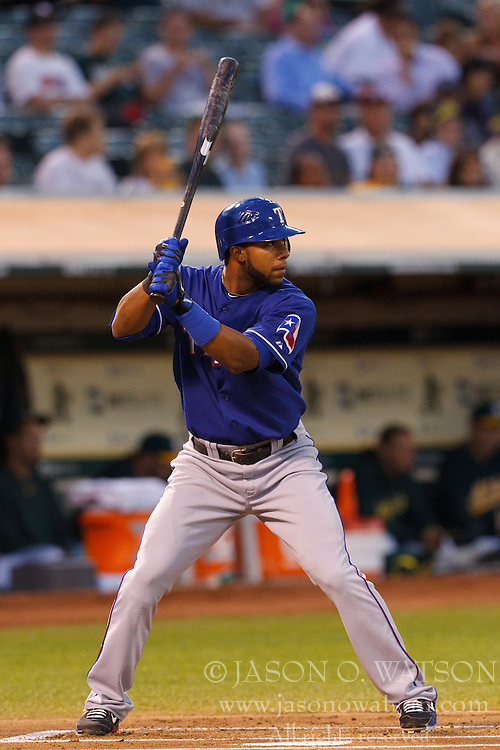 September 20, 2011; Oakland, CA, USA;  Texas Rangers shortstop Elvis Andrus (1) at bat against the Oakland Athletics during the first inning at O.co Coliseum.  Texas defeated Oakland 7-2.