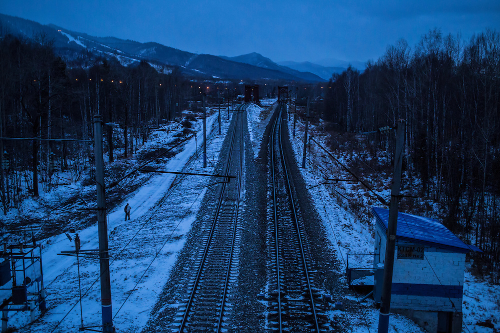 A man walks along the train tracks on Monday, October 21, 2013 in Baikalsk, Russia.