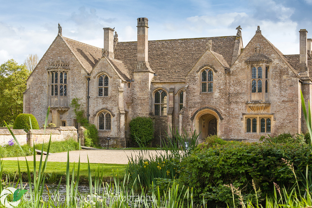 Great Chalfield Manor, at Great Chalfield, near Bradford-on-Avon, Wiltshire is a <br /> moated manor house built around 1465&ndash;1480. It was restored and furnished between 1905 and 1911. The manor&rsquo;s gardens and surroundings boast topiary, terraces, a gazebo and roses as well as a lily pond and spring-fed fishpond. All Saints parish church stands next to the house.  The property, but not the church, are owned by the National Trust.