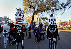 09 February 2016. New Orleans, Louisiana.<br /> Mardi Gras Day. Walking with Skeletons. The Skeleton Krewe meet before sunrise and walk 5 miles from Uptown, making their way along St Charles Avenue and into the French Quarter where they celebrate Mardi Gras Day.<br /> Photo&copy;; Charlie Varley/varleypix.com