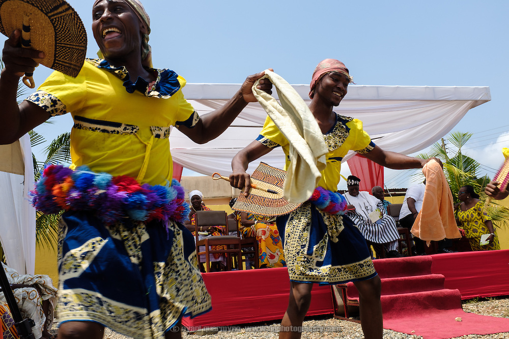 Traditional dancers at a swearing-in ceremony for newly elected members of a council of Queen Mothers in Accra, Ghana on 23 June 2015. A queen mother is a traditional female leader, drawn from the relevant chiefly lineage, who is responsible for women's and children's issues in particular. Though often widely respected and sometimes powerful, especially in matrilineal ethnic groups, their authority is subject to a male chief. After being suppressed during the colonial era, the role of queen mother is being revived in Ghana and is seen by many as a force for development.