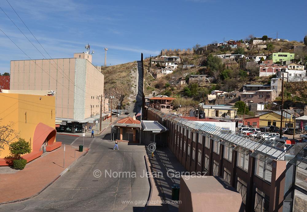 Pedestrians cross between Arizona and Sonora, Mexico, at the U.S. Customs and Border Protection, Morley Gate Border Station, Nogales, Arizona, USA.