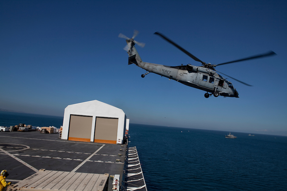 An MH-60S helicopter takes off from the USNS Comfort, a U.S. Naval hospital ship, after delivering Haitian earthquake victims needing medical treatment on January 21, 2010 in Port-au-Prince, Haiti. The Comfort deployed from Baltimore with 550 medical personnel on board to treat victims of Haiti's recent earthquake, and arrived on January 20.