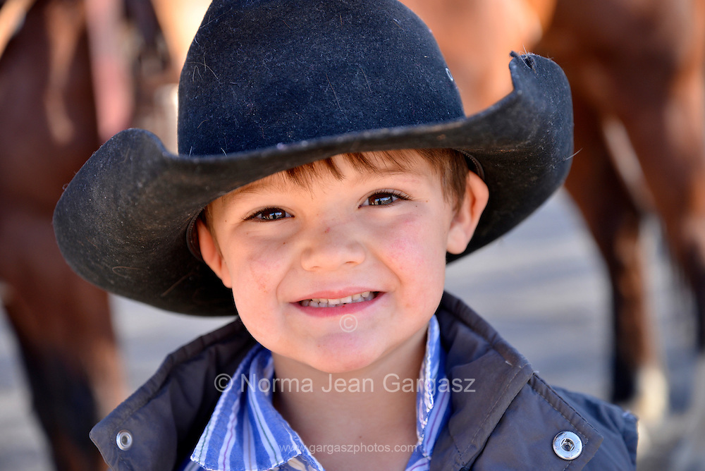 Cutter Lewis, 4, flashes a smile before the start of the Tucson Rodeo Parade, the longest non-motorized parade in the nation. This 89-year-old event occurs each February in conjunction with La Fiesta de los Vaqueros, the Tucson Rodeo.  The event draws over 150,000 spectators in southern Tucson.