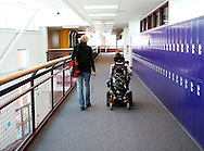 Because of his wheel chair, and having to sometimes cross the entire length of the school just to get to the elevator, AJ Novotny and one of the Adult Special Education assistants leave class early before the halls are filled with kids.