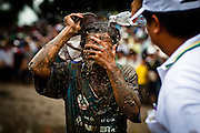 To celebrate the last day of their calendar and honor their ancestors, the ethnic Khmer peoples living in the Mekong Delta region of Vietnam, and many who cross the border, hold an annual cow racing festival. Taking place on the grounds of a pagoda in Tri Ton, near the border with Cambodia, two pairs of cows with a driver in tow, race around a muddy circular track, as spectators flow up to the edges of the course. The winner can take home about three thousand dollars, a very large sum for nearly all people living in either country.