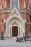 Family walk past St Joseph's Church door in Podgorze Krakow Poland