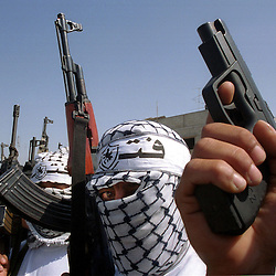 Palestinian Hamas supporters display a show of force at a protest in Gaza, Monday, October 16, 2000. Many Palestinians are angry that Yassar Arafat agreed to attend the crisis summit in Egypt which is meant to stop the spiral of violence in the Middle East. (Photo by Ami Vitale)