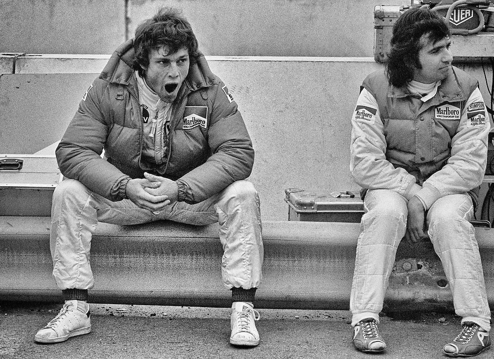 Having qualified second for the 1982 Detroit Grand Prix, Italy&rsquo;s Andrea deCesaris tries to shed some nervous energy while engineer Ermanno Cuoghi prepares his Marlboro Alfa-Romeo before the start. <br /> <br /> A former World Karting Champion, he would drive for eight teams in over 208 races during his F1 career without ever having a victory. <br /> <br /> Here in Detroit, his transmission would fail on lap 2.