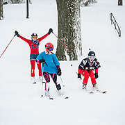 02/09/2013 - Medford/Somerville, Mass. Tufts Ski team members Anna Richardson, A16, Michelle Zackin, A15, and K.C. Hambleton, A15 hit the slopes on the hill after a record snowfall on Saturday, February 9, 2013. (Alonso Nichols/Tufts University)