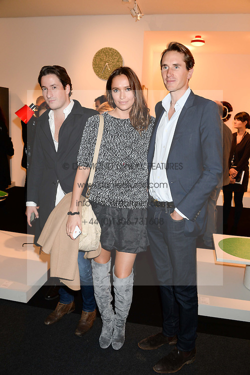 Left to right, BLAISE PATRICK, SASHA VOLKOVA and OTIS FERRY at the PAD Art and Design Fair 2013 Collectors Preview in Berkeley Square, London on 14th October 2013.