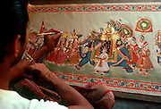 INDIA, ARTS and MUSIC Artist painting Rajput procession painting in Udaipur in Rajasthan