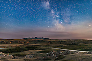 The summer Milky Way in moonlight from a setting waxing Moon off frame at right and with deep twilight still lighting the sky, at the Battle Scene viewpoint at Writing-on-Stone Provincial Park, in southern Alberta. Sagittarius and the galactic centre is on the horizon at centre. Saturn is at far right. On the horizon are the Sweetgrass Hills in Montana. The Milk River winds below amid the sandstone formations that are home to historic First Nations petroglyphs. Clouds and forest fire smoke obscure the sky at low altitudes.<br /> <br /> This is a single 30-second exposure with the Nikon D750 at ISO 3200 and Sigma 24mm Art lens at f/2, taken as part of a time-lapse sequence.