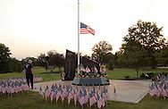 Washingtonville, N.Y. - A man stands at the Washingtonville 5 Firefighters World Trade Center Memorial before a candlelight service on Sept. 11, 2008. The Memorial was built in honor of five FDNY firefighters from Washingtonville and the many others who lost their lives on September 11, 2001 in the World Trade Center terrorist attack.