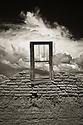Old window and adobe ruins which once stood near Abiquiu, New Mexico.